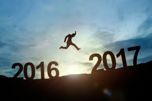 Silhouette of businessman glowing jump 2016 to 2017. success con